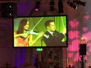 FUSE electric violinists peform